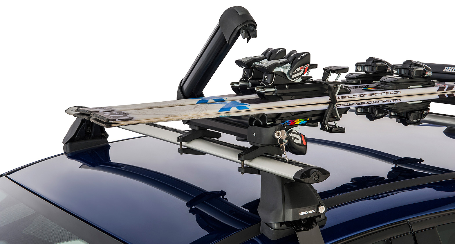 Ski carrier and fishing rod holder holds 2 skis or 1 for Roof rack fishing pole holder