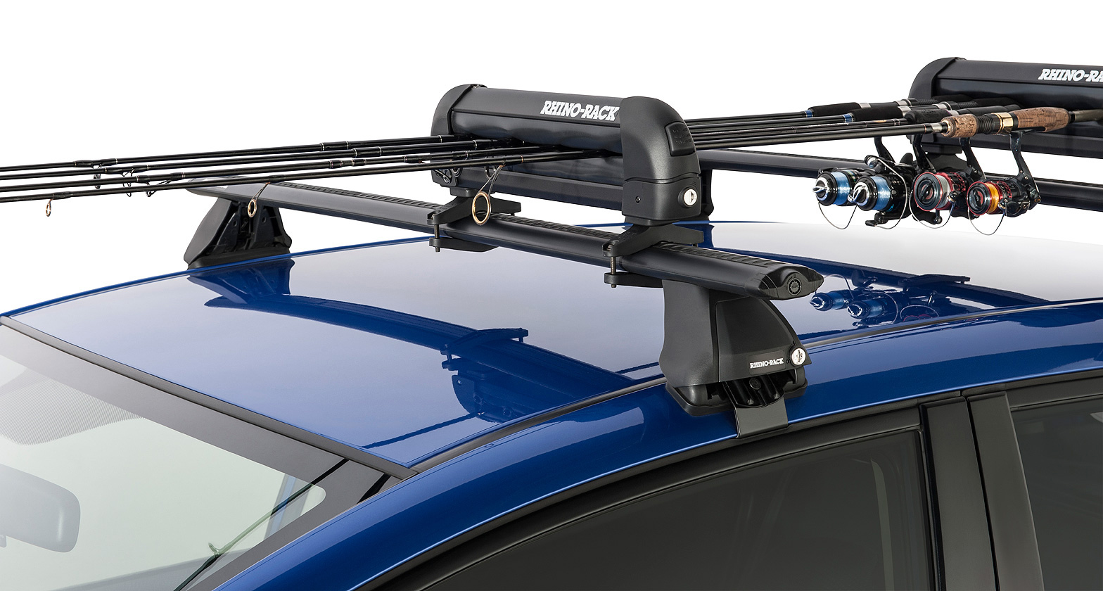 Ski carrier and fishing rod holder holds 3 skis or 2 for Roof rack fishing rod holder